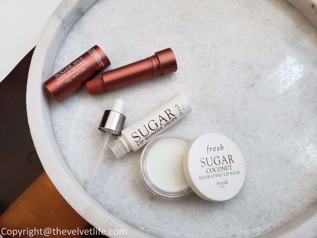 Fresh Sugar Lip Wonder Drops Advanced Therapy, Fresh Sugar Coconut Hydrating Lip Balm, and Sugar Spice Tinted Lip Treatment Sunscreen 15