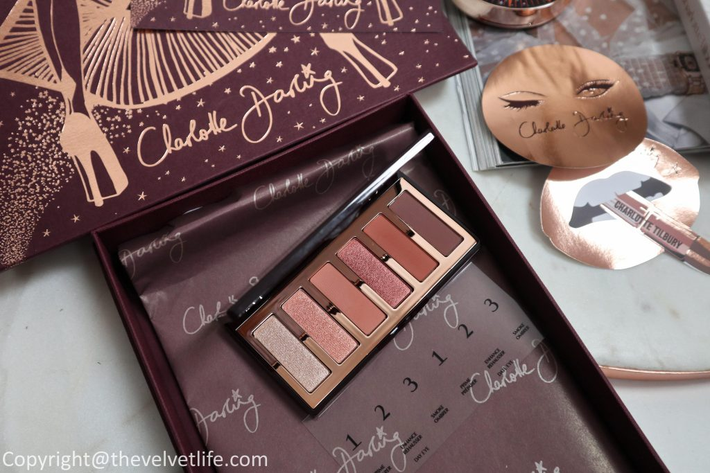 Review and swatches of new Charlotte Darling palette, Charlotte's Magic Star highlighter, Hollywood Beauty Glow Face Kit, Light Wand in spotlight