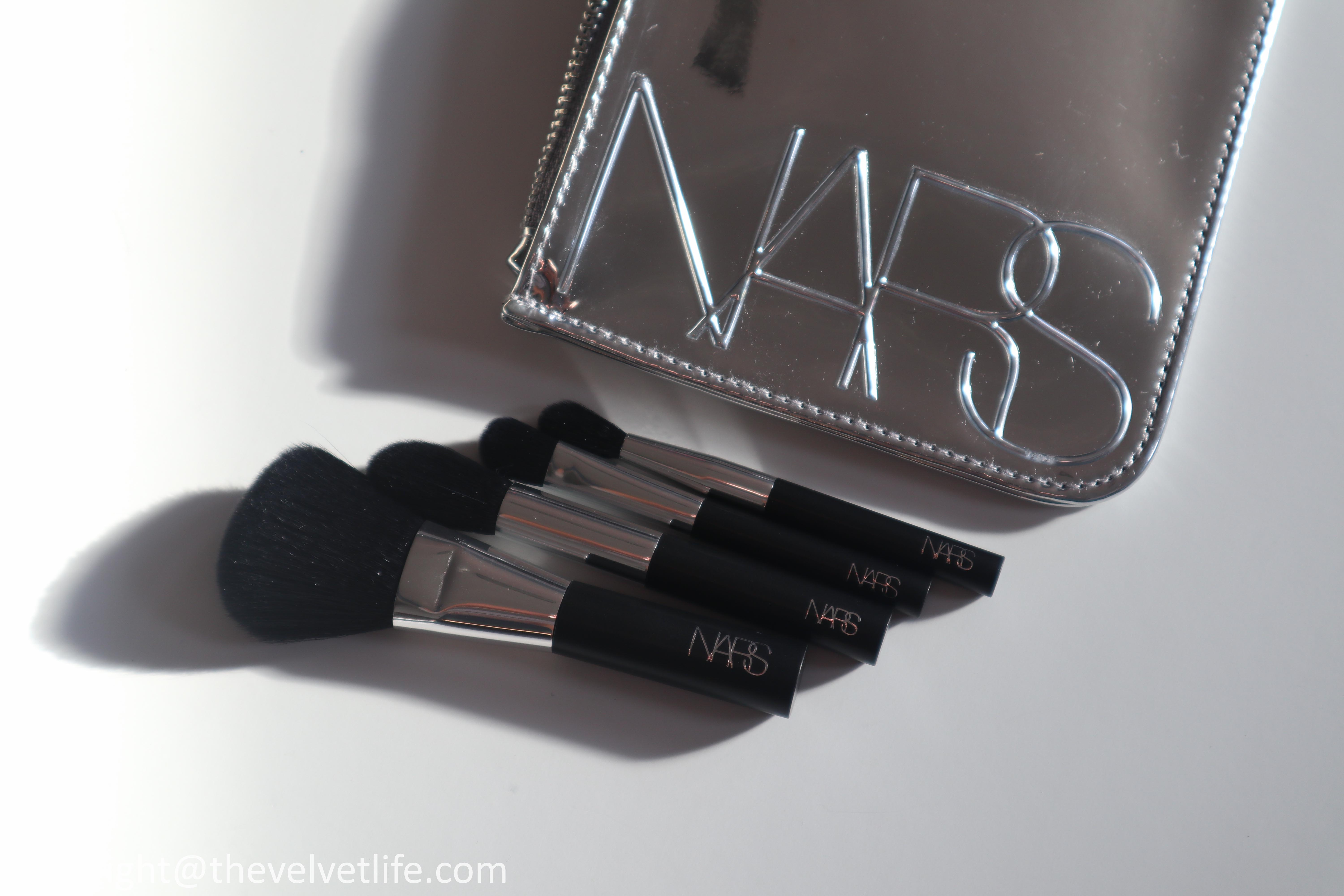 Nars Holiday 2020 collection review swatches Iconic Glow Cheek Duo, Undress Code Lip Balm Set, VIP Audacious Lipstick, and Mini Brush Set